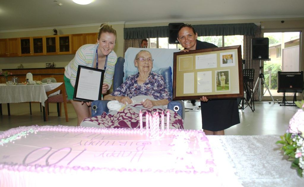 Malvie Chesterfield yesterday celebrated her 100th birthday and Oaks Nursing Home staff Sherry Phillips and Marilla Reid present her with accolades from the Queen and Prime Minister.
